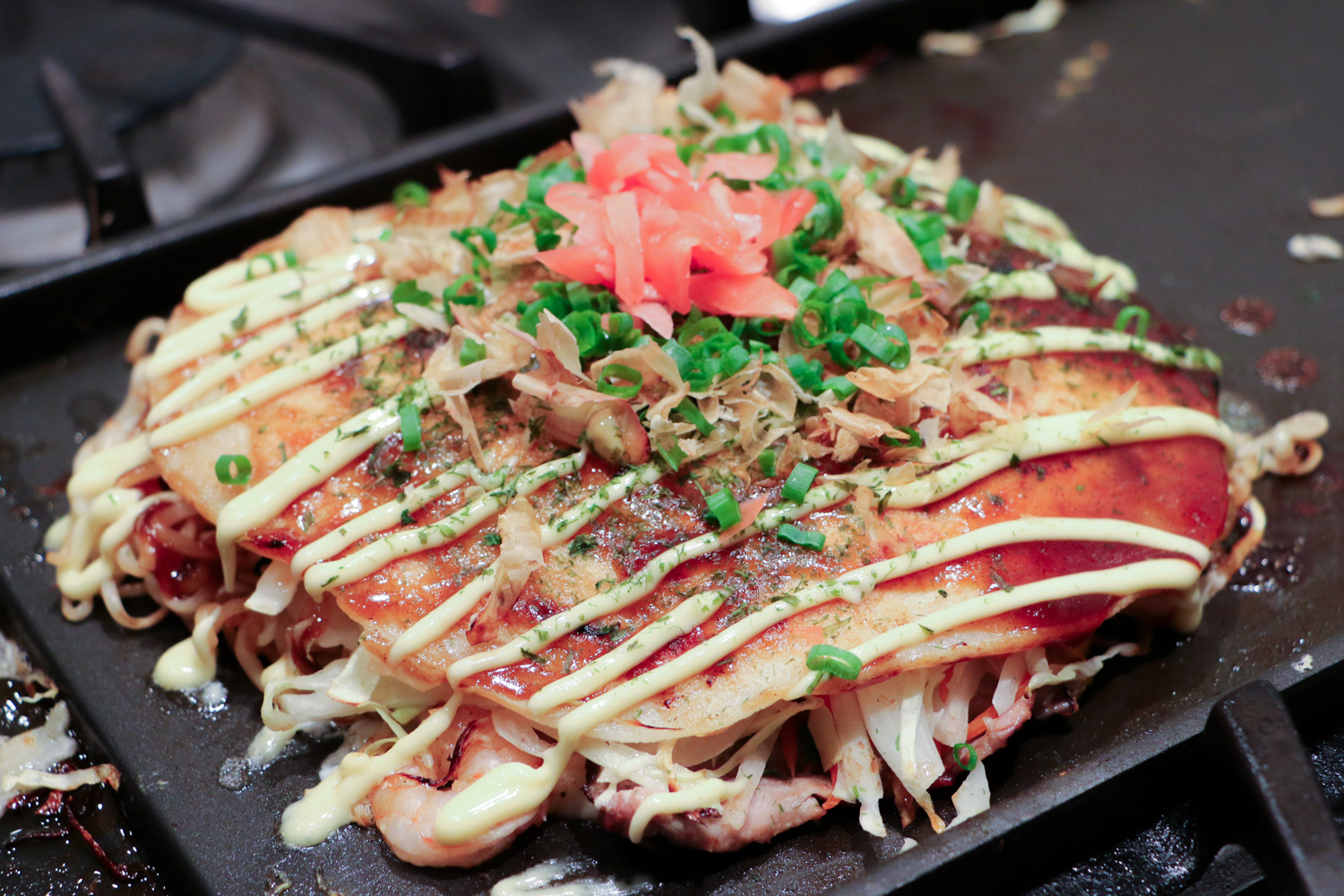 Okonomiyaki all dressed up on the grill