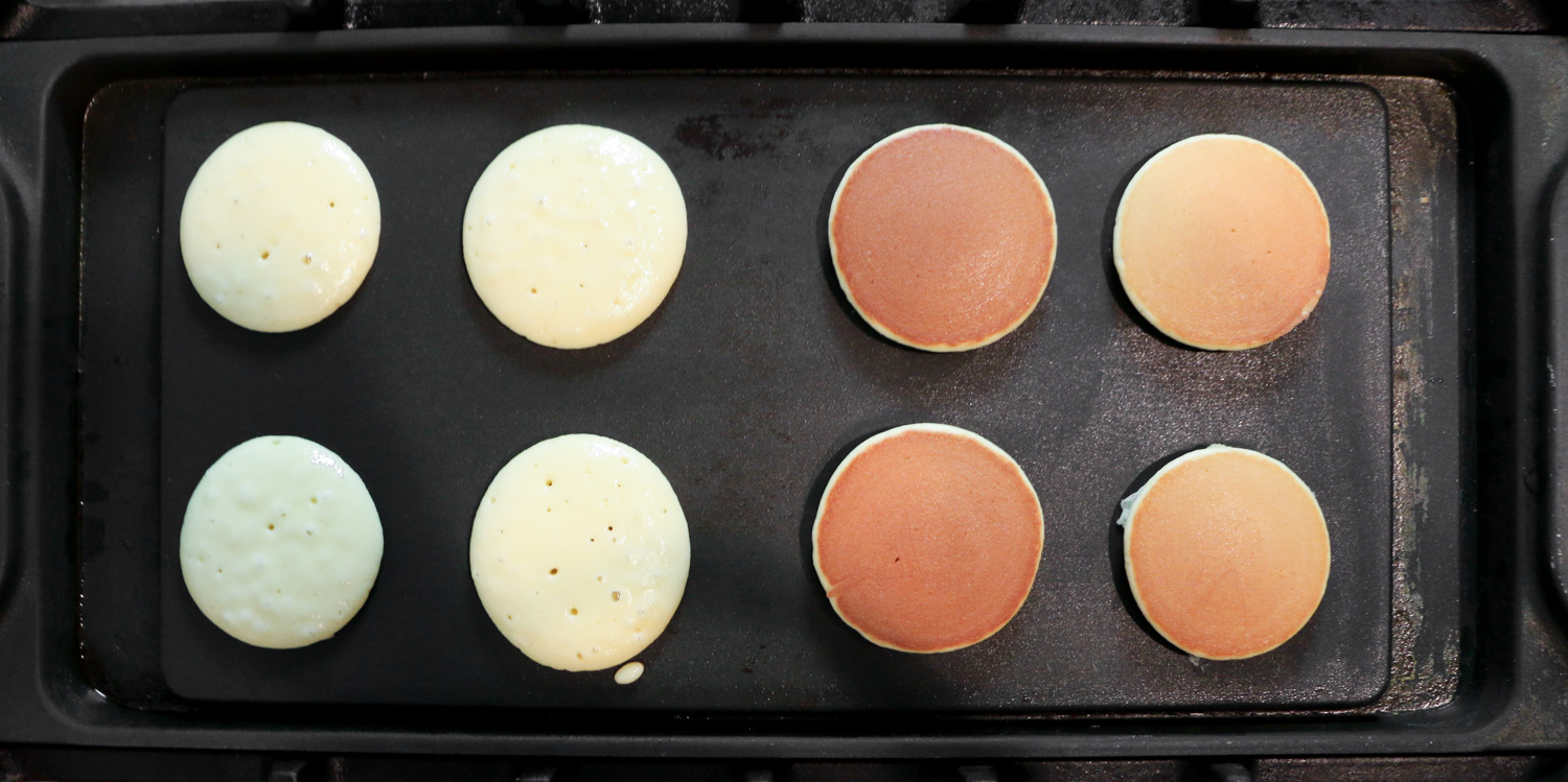The different stages of cooking dorayaki on a griddle