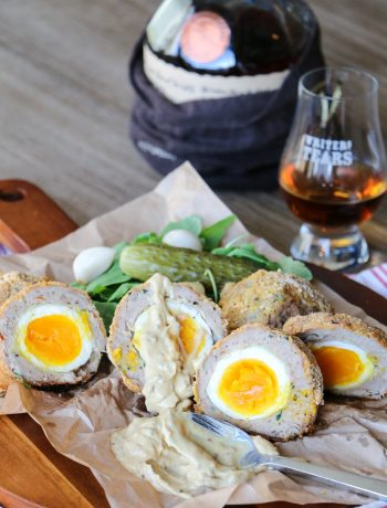 Scotch eggs with pickles and a drink of Scotch